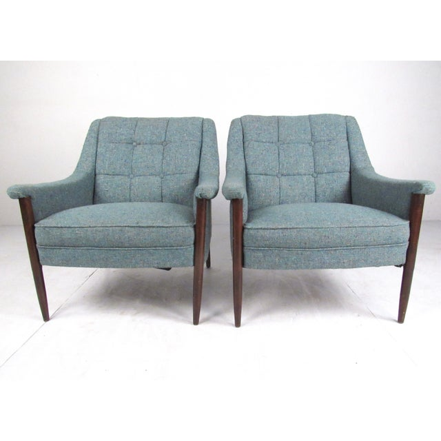This pair of vintage modern lounge chairs feature walnut frames, shapely Danish Modern seat design, and tufted vintage...
