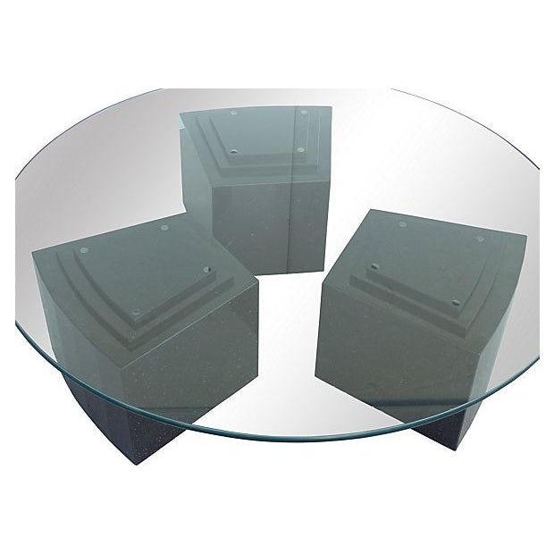 """This is a large coffee table composed of three granite stepped bases supporting a round .75"""" glass top with rounded edges...."""