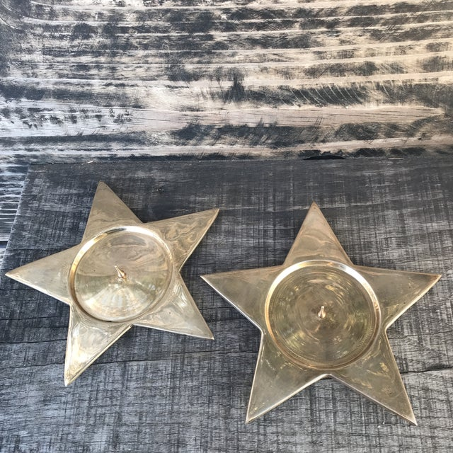 """Gorgeous star shaped brass candle holders for 3"""" or smaller pillar candle. Round candle base area measurements are 3""""..."""