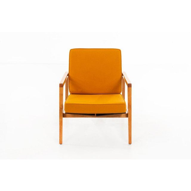 Lewis Butler Model no. 655 Pair of arm lounge chairs with maple frames and walnut backs. Executed by Knoll. American, c....