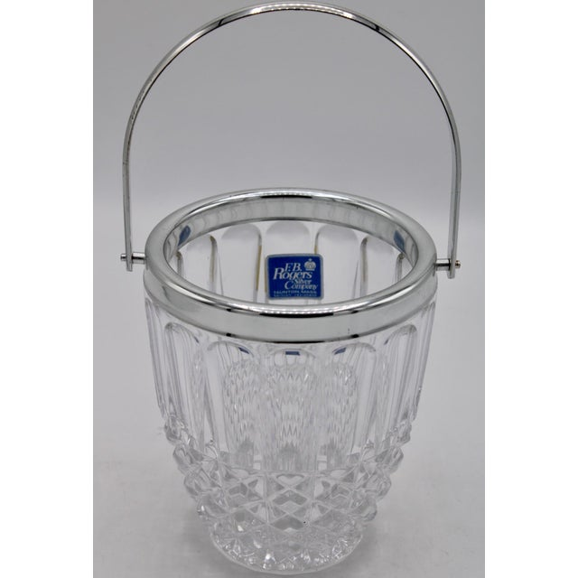 Mid-Century heavy and thick, crystal ice bucket with silver plated handle and rim. This ice bucket has a thick lead cut...