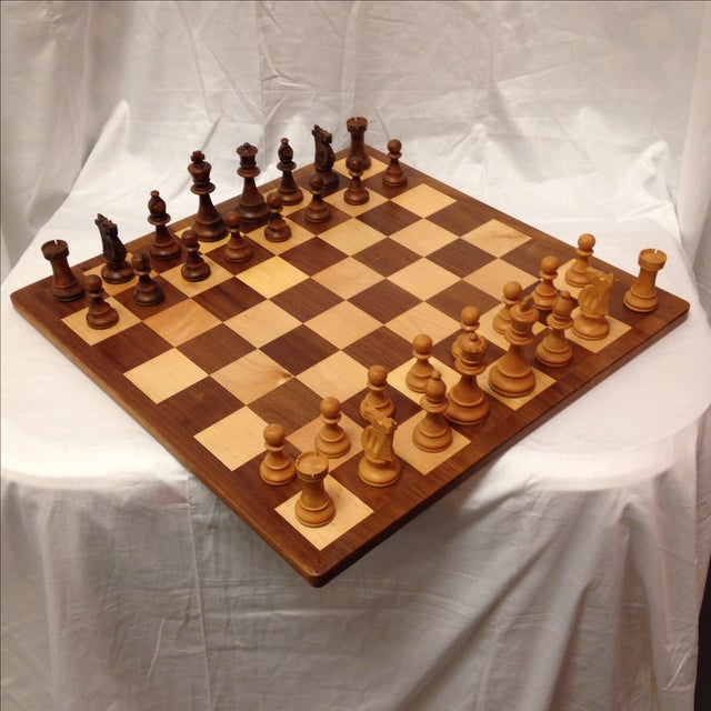 This is a fantastic chess set with hand carved walnut wood pieces. This set was made in Michigan by Drueke & Sons Co. The...