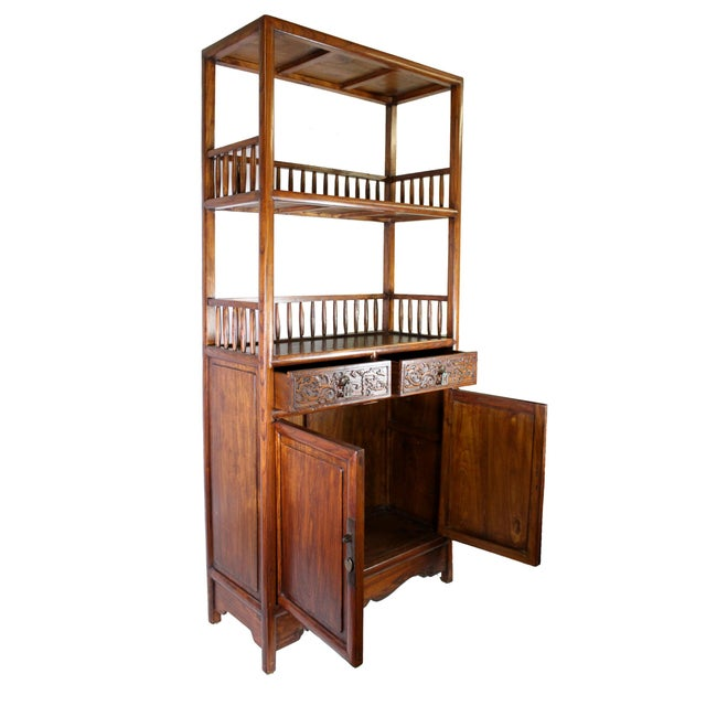 A rare combination of shelves and enclosed cabinet, all wood fretwork constructed entirely by hand in the traditional...