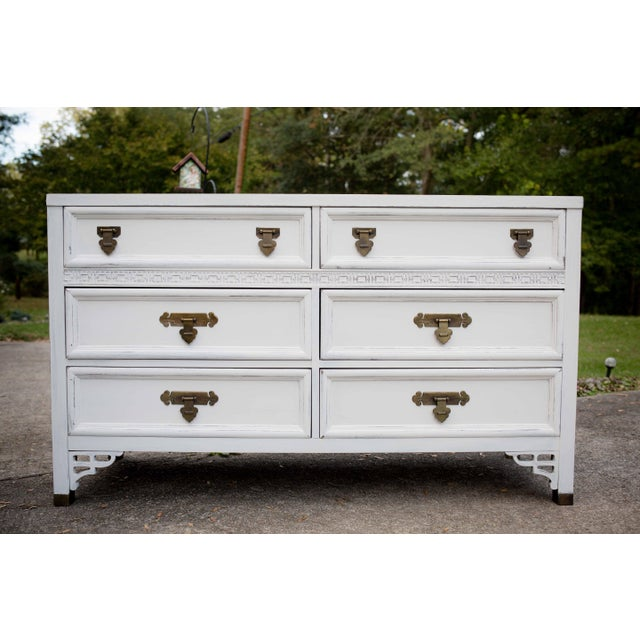 Dresser has been painted in an antique white chalk paint, distressed, and waxed. The top has two coats of a satin...