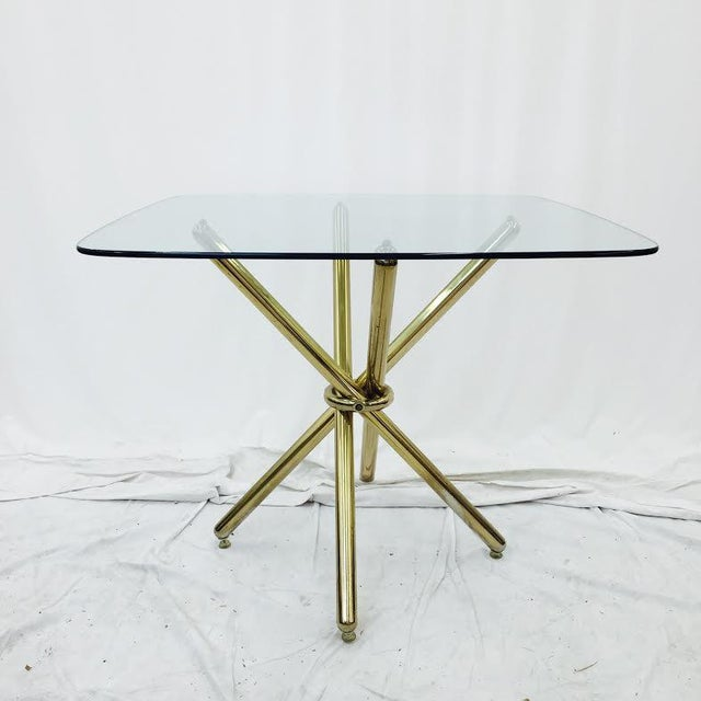 Vintage Mid-Century Modern lacquered brass knot side table with large glass top. Designer. Brass shows minor wear (see...