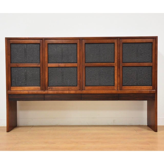 A beautiful walnut sideboard credenza with four rosewood drawers, four adjustable shelves, and four black Japanese relief...