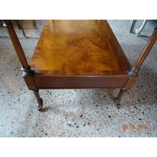 A treasure from the 1940's.... Leather top embossed with gold trim and veneer all around. The wood is walnut . This table...