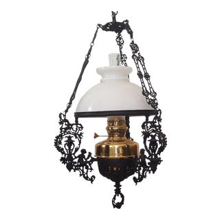 Early 20th Century Brass Hanging Oil Lamp With Cast Iron Cherubs Chandelier Milk Glass Globe For Sale