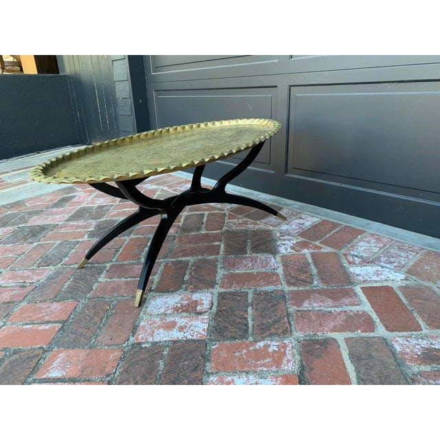 Mid centurary modern Indian Morrocan Oval Brass Top Spider Folding base with sabot feet Coffee Table - base has been...