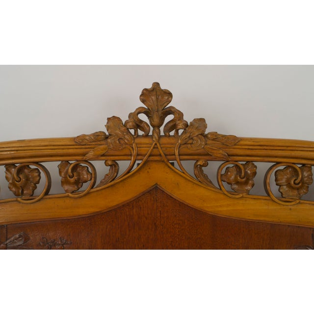 French Art Nouveau maple full size headboard (only) bed having a carved & filigree floral and vine design carved edge...