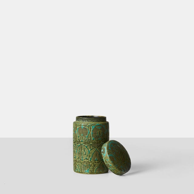 A glazed stoneware jar with a geometric, abstract design in relief. Designed by Nils Thorsson for Royal Copenhagen. Marked...