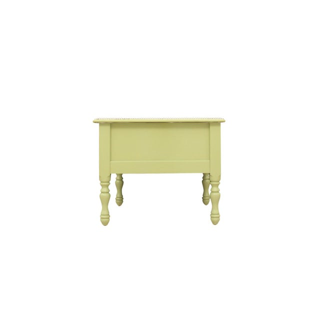 Two matching lime-green end tables with silver detailing. Each table top is wrapped with faux lime-green leather with...