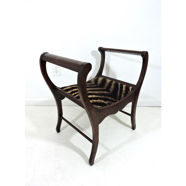 Early 20th C. elegantly shaped mahogany window seat or bench that has been newly webbed & newly upholstered in Kravet...