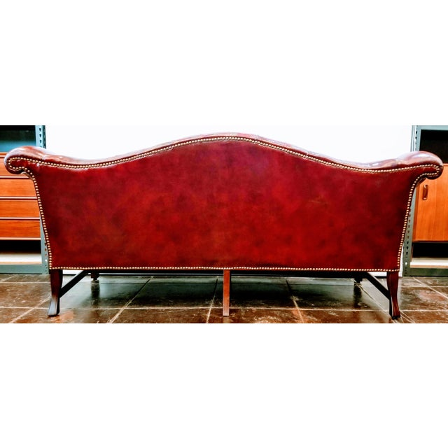 Traditional Vintage Burgundy Leather Button Tufted Camel Back Sofa With Antiqued Brass Nailheads For Sale - Image 3 of 10