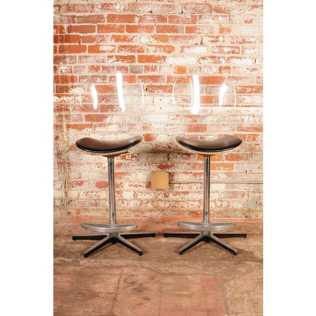 """Mid-century modern pair of Lucite bar stools with leather seats, circa 1960s. Seats are 28"""" high A beautiful piece that..."""