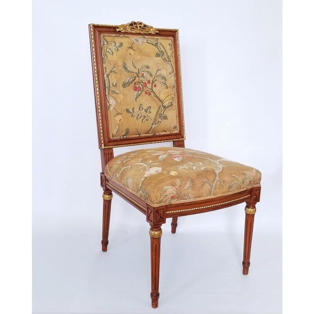 Offering a lovely vintage Mid Century Louis XVI French Directoire style chair, circa 1960s. This beautiful chair has a...