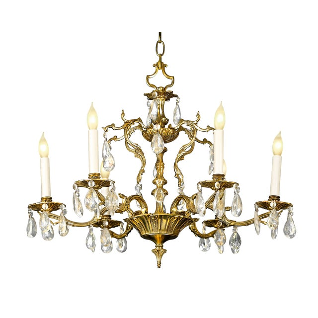 This exceptional doré bronze chandelier is crafted in an exuberant, Rococo-inspired design. Six vine-like scrolling...
