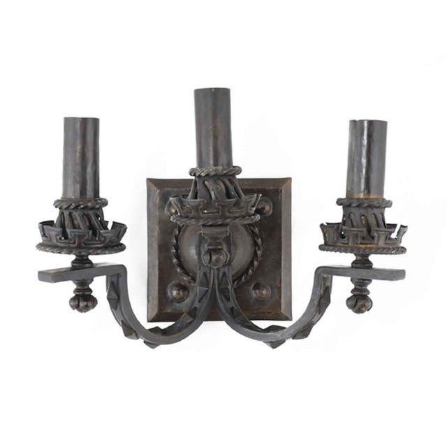 American made triple arm sconces from 1910. These pieces are fashioned out of hand hammered bronze and presented in an...