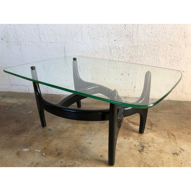 Vintage Mid Century Modern Glass Top Side Table in the Style of Adrian Pearsall. This unique side table features an...