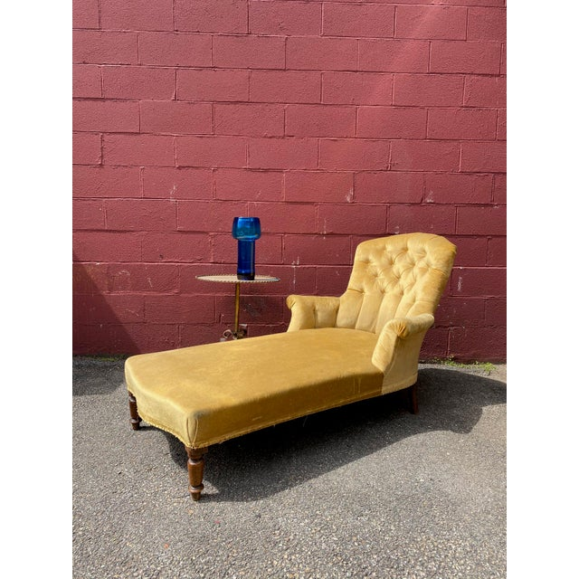 French 19th century Napoleon III chaise longue upholstered and tufted in gold velvet. The chaise is very comfortable. Sold...