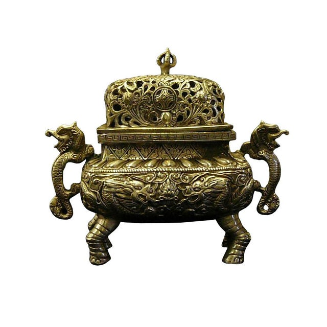 This is a decorative container made of a mixed material with silver coating color. The body is crafted with relief motif...