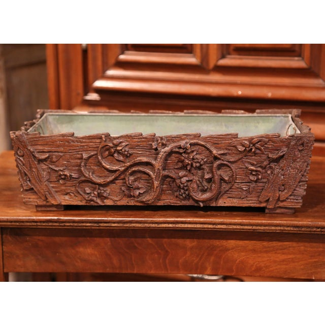 This beautiful, walnut, Black Forest jardiniere carved as a log was crafted in France, circa 1870. The rectangular...
