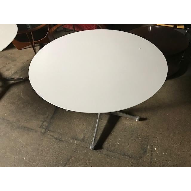 Eames table with beveled white laminate top. The bottom side of the top has been refinished. This is a classic Ray and...