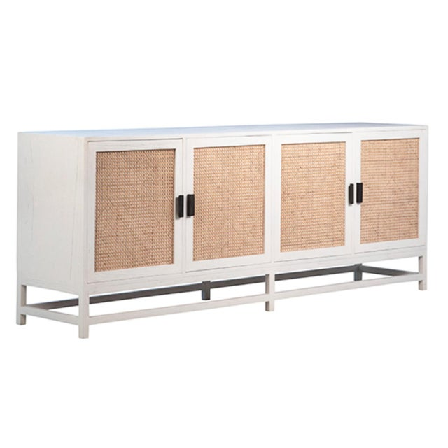 Modern ivory white finish teak wood frame sideboard with natural cane inset cabinet doors. Ample storage inside. Each...