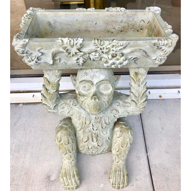 Beautiful and very detailed composite planter. Sitting monkey holding a grapes and vines decorated rectangular planter....