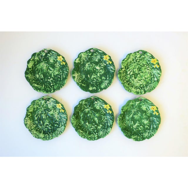A beautiful set of six Italian green and yellow matte pottery plates with lotus leaf and flower design by designer Ed...