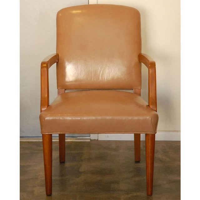 Two very nice upholstered armchairs that are done in slightly different toned vinyl. These chairs are a good example of...