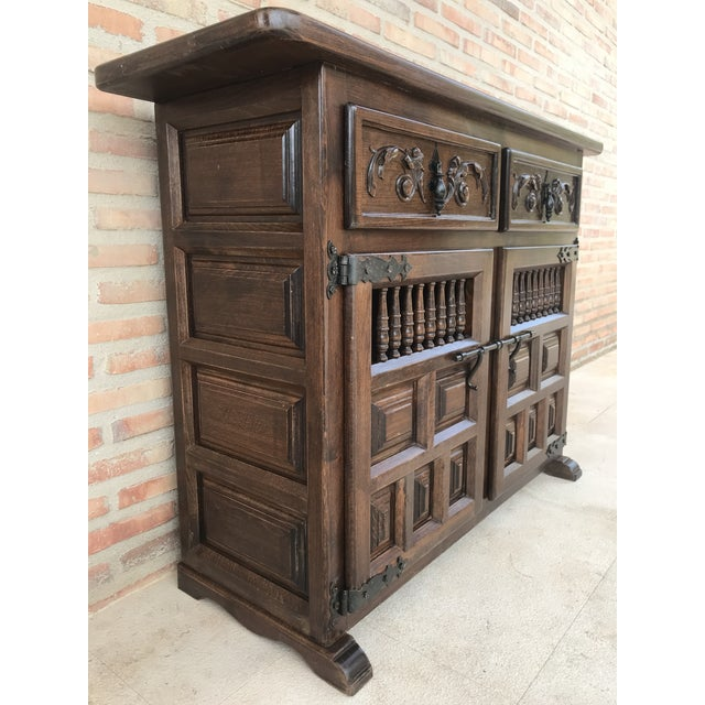 About From Northern Spain, constructed of solid walnut, the rectangular top with molded edge atop a conforming case...
