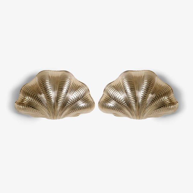 The excellence of Italian craftsmanship. A pair of artfully designed sconces from the Mid-Century, still in outstanding...