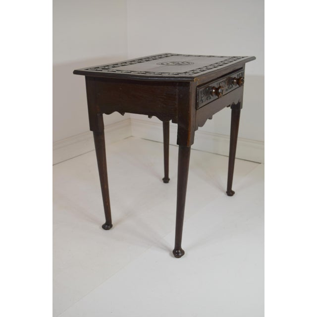 18th-Century English Georgian Oak Table with a single large drawer. Beautiful carving along the outer edge and center of...