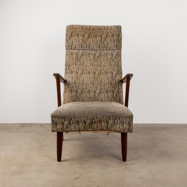 A classic Danish mid-century modern high-back chair with teak arms – made circa 1960s.