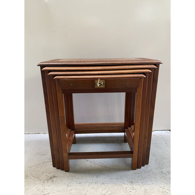 Gorgeous and elegant very detail set of stacking tables. Beautiful design with carving and inlaid metal details. The...