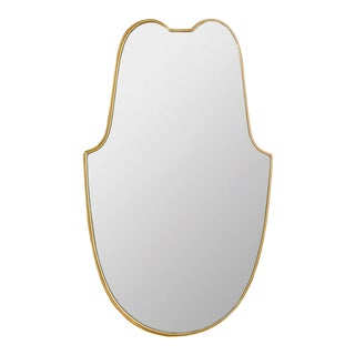 Mid-Century Italian brass mirror having a shaped frame circa 1950. For Sale
