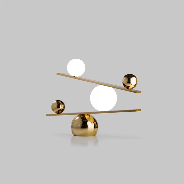 Balance brass table lamp by Victor Castanera Balance is a playful and curiosity evoking tribute to the concepts of gravity...