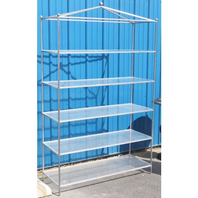 Chrome etagere with lucite shevles. Elegant, practical and stylish. Perfect for housing accessories or books. Can act as...