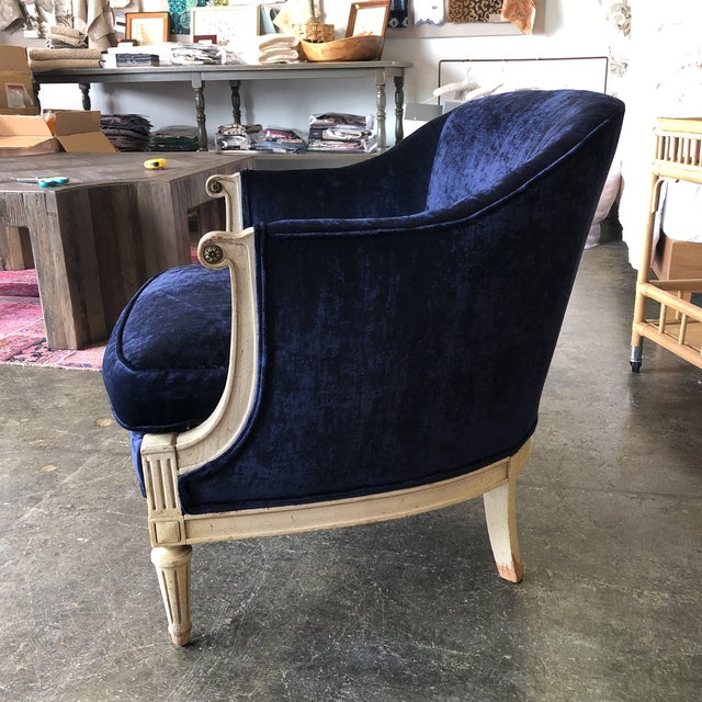 Beautiful, vintage barrel chair with worn cream painted wood and brand new luster velvet upholstery. The chair is...