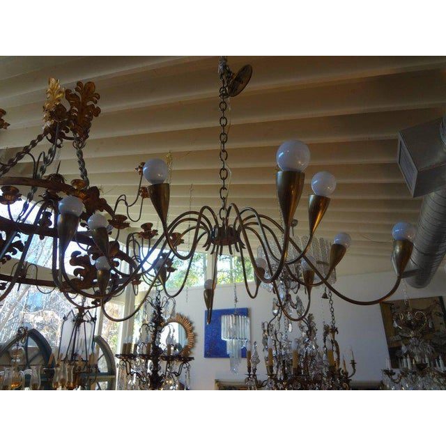 Beautifully designed Italian Stilnovo Style Mid Century Modern 12 Light Brass Chandelier. This Chandelier Has Been Newly...