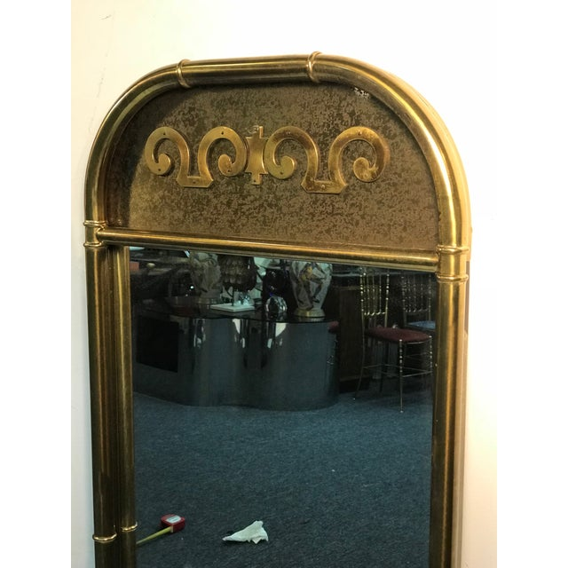 Pair of exceptional brass mirrors by Mastercraft, 1970's. Some wear appropriate with age and use, overall good condition....