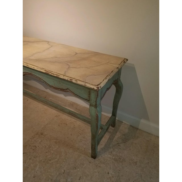 Nierman Weeks French console table with turquoise base, cabriole legs and faux travertine top. Heavily distressed. The...