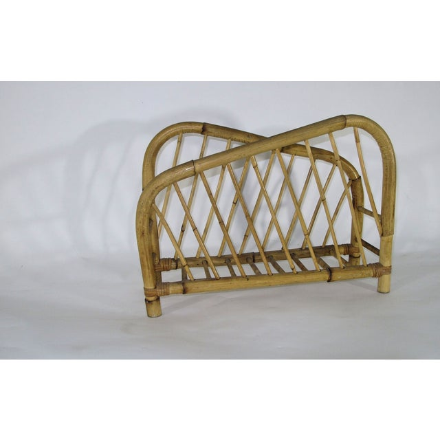 This stylish and imaginative 1960s bamboo composition has diametrically opposed arms that slant down to base of rack.