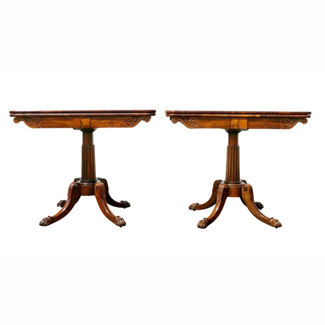 Each with a rectangular hinged top over a frieze with vitruvian carved and scrolled ends, raised on a tapered reeded...