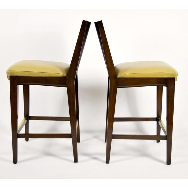 A beautiful pair of barstools by Axis. Kenya - tight seat with dark wood stained combed wood back, metal plate on foot...