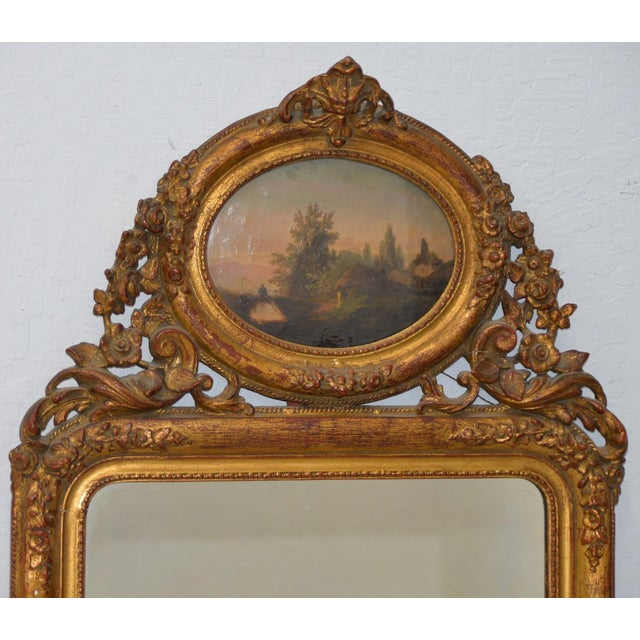 Early 19th Century Painted & Gilt Frame Mirror Finely carved gilded & gesso framed mirror. The original painting on top...