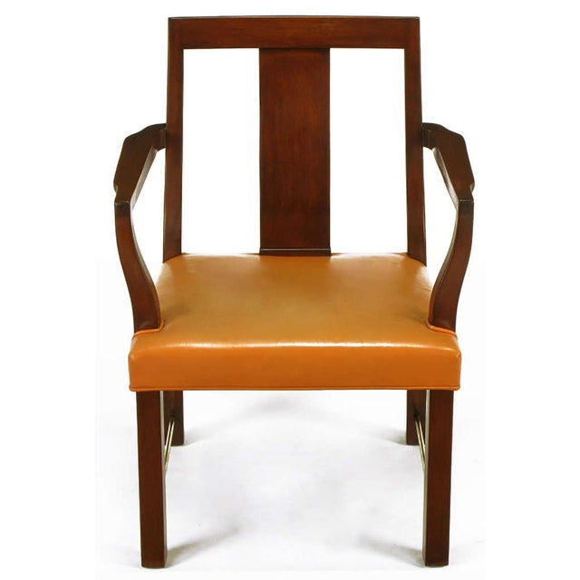 Set of eight mahogany wood and apricot leather curved panel back dining chairs by Edward Wormley for Dunbar. Set is...