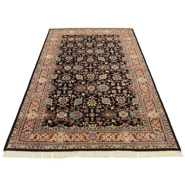 Offered is a hand knotted wool Indian Persian design rug. All over multi color designs.