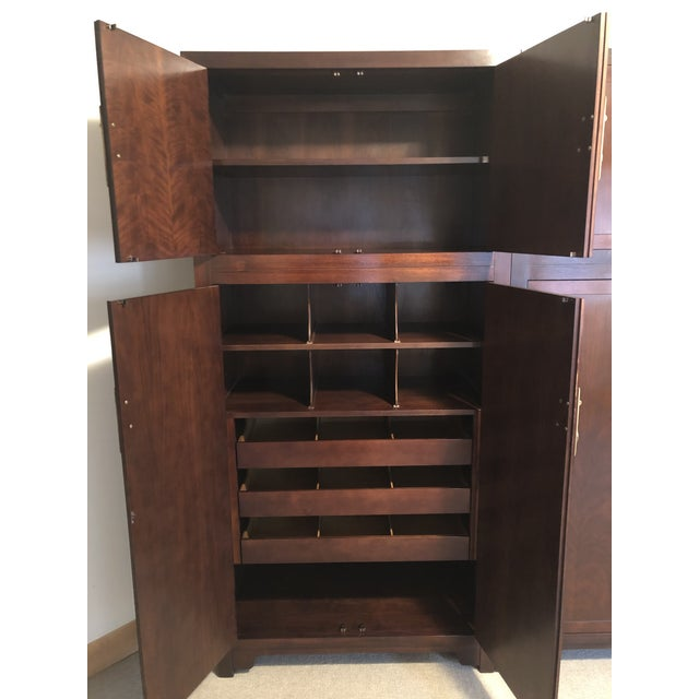 Stunning one-of-a-kind Michael Taylor inspired Far East Collection armoires in polished mahogany finish by Baker. The...